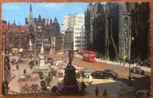 View of Albert Square showing a double decker bus outside the Town Hall before the stones were cleaned