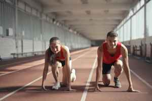 A young woman and young man in the starting position for a marathon