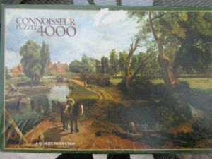 The 4000 piece jigsaw puzzle box showing the painting of Flatford Mill.