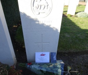 A simple white headstone with the engraving Private S.C. Clark, 22nd Bn London Regiment, 3rd January 1916 and a cross