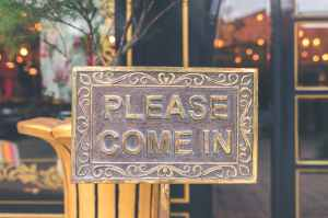 "sign on a front door saying ""Please come in"""