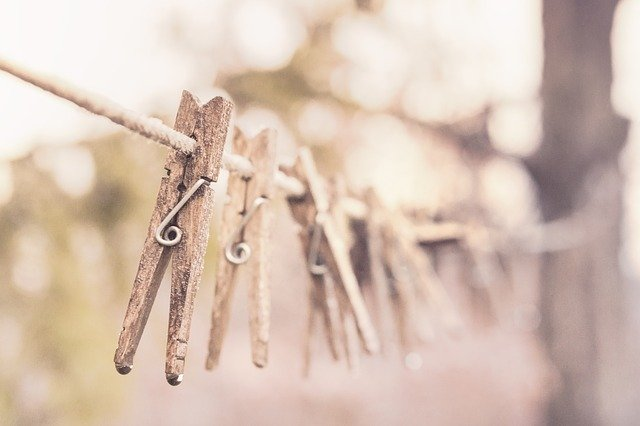 Wooden pegs on a washing line