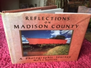 A photograph of the front cover of the book, Reflections on Madison County: a photographic journey by Mark E. Heffron