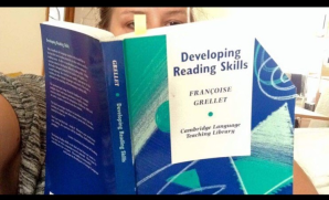 Lucy reading a book by Francoise Grellet with the title Developing reading skills, from the Cambridge Language Teaching Library
