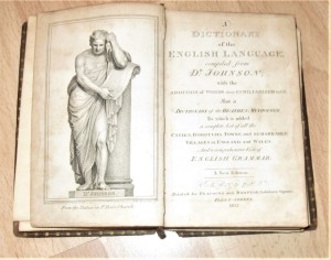 The title page of A Dictionary of the English Language, with an illustration of a statue of Samuel Johnson from St. Paul's Church